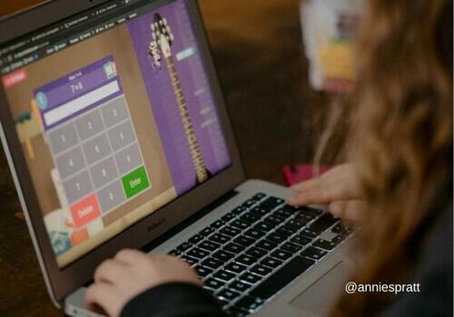 Girl doing math on laptop